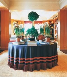 I'm glad my personal crusade to bring back the skirted round table (especially with twisted silk cord fringe) is supported by Tory Burch - as displayed here in the stunning orange library in her Upper East Side apartment.
