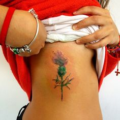 Little Watercolor Thistle tattoo