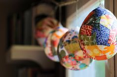 "papier mache ""lantern"" decorations with beautiful, colorful paper"