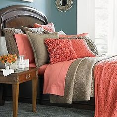 Love coral for a guest bedroom with gray or tan