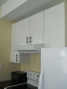 Our kitchen-White Kitchen Cabinets, dark handles, ivory  walls