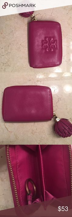 AUTHENTIC TORY BURCH TASSEL LEATHER LOGO WALLET AUTHENTIC TORY BURCH TASSEL LEATHER LOGO WALLET. Zip around, pull out key fob. Very good used condition Tory Burch Bags Wallets