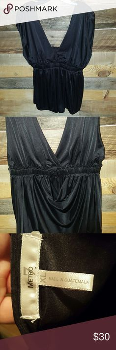 GODDESS TOP METRO 7 LIKE NEW GODDESS DRAPED TOP SHORT SLEEVES SIZE XL COLOR BLACK FITS LOOSE GORGEOIS FLOWY TOP DEEP FRONT & BACK NECKLINE SOFT GATHERED WAIST DRAPING DETAIL IN BACK GREAT TOO FOR DAY OR NIGHT! *NO TRADES NO MODELING NO RETURNS* Metro 7 Tops Blouses