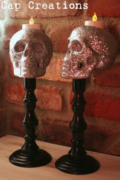 Glitter Sprayed Dollar Store Skull..glitter skulls $1 each and a 2 pack of battery powered tealight candles $1 for the pack. The wooden candlesticks are from a thrift store and paid a whole 74 cents for the set!   DO NOT USE REAL CANDLES ~~