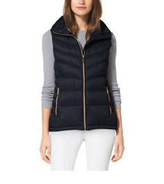 Perfect when you need an extra layer, this lightweight vest is quilted in waterproof nylon for a cozy, textured effect, while the gold-tone hardware speaks to our signature glamour. Layer it over a sweater and denim for weekends spent outdoors.