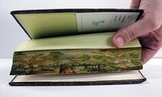 "It's very possible that one of your battered old books contains an amazing secret called a ""fore-edge painting,"" which is an illustration that is hidden on the edge of the pages of the book. The technique allegedly dates back to the 1650s. You can see the painting by bending together the pages of the book, just so you can see a small piece of each page."