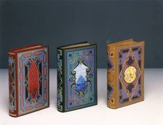Divina Commedia, Leather design bindings with leather onlays and drawings. Bound by Luciano Fagnola. Drawings by Guido Giordano