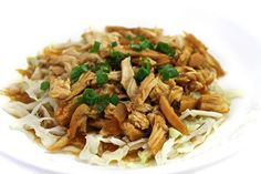 6 SP  Tenderly cooked and shredded chicken, in a fabulous, honey garlic sauce….It's over the top delicious! Such a versatile dish. I love serving it over shredded, steamed cabbage, as shown in the …
