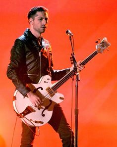 Michael Shuman-Queens of the Stone Age