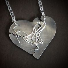 """Resilience mended heart fine silver heart on sterling silver chain. Inspired by the art of """"Kintsugi (Japanese:golden joinery)  orKintsukuroi(Japanese:golden repair) Defined as """"to repair with gold""""is theJapanese artof repairing brokenpotterywithlacquerdusted or mixed with powderedgold,silver, orplatinum, a method similar to themaki-etechnique.As aphilosophyit treats breakage and repair as part of the history of an object, rather than something to disguise."""""""