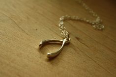 Sterling Silver Wishbone Necklace Simple Pendant by FreshyFig. $26,00 USD, via Etsy.