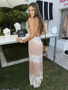 Boho babe: Alessandra Ambrosio showed off her svelte shape in a backless maxi dress as she launched her Ale By Alessandra For BaubleBar Jewelry Collection at Popsugar + Shopstyle's Cabana Club at the Avalon Hotel in Palm Springs, California on Friday