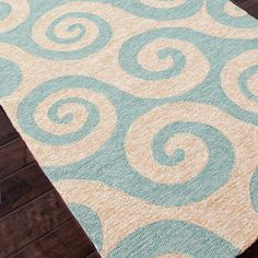 Coastal rug in beige and blue is perfect for outdoor patios and porches. Designed to withstand outdoor elements,