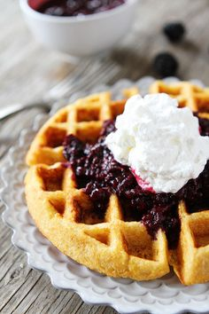 Cornmeal Waffles with Blackberry Compote Recipe on twopeasandtheirpod.com. Waffle perfection! These waffles are amazing!