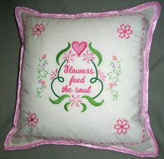 A pillow embroidered with a flowers feed the soul design.
