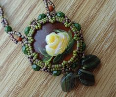 Oculus Pendant by Sam Wescott (Pattern Available) with hand-painted Luna cab by Brenda Meyer