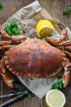 crab, parchment, lemon, rough boards, greens