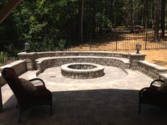 Parrot Bay Pools and Spas Firepit area near pool seat bench pavers