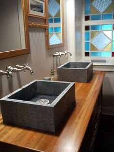 Soapstone sinks atop wood countertops add so much warmth to this bathroom. The look reminds me of the natural beauty of a rock outcropping i...