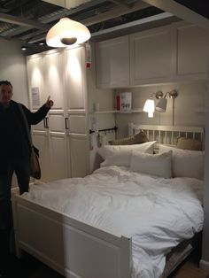 IKEA bedroom idea - with Expedit shelving instead, in black, and minus the weird dude.