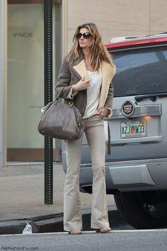 Gisele Bundchen street style with aviator jacket and Miu Miu handbag (March 2015). #giselebundchen