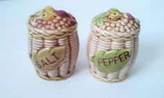 Fruit Basket Salt and Pepper Shakers  One of the stoppers is missing.  3 inches tall 2 inches wide.  53/206 on the bottom of each one  Brown colored basket with fruit colors on the top. #Vintage #Shakers