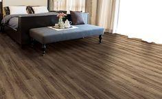 Get the look of hardwood in a material that's more durable and easier to clean. Find vinyl flooring in sheets, tiles, and planks today at Avalon Flooring. Vinyl Planks, Vinyl Flooring, Tiles For Sale, Do It Yourself Projects, Home Improvement Projects, Home Kitchens, Tile Floor, Family Room, Hardwood