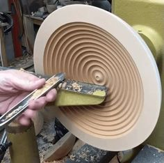 Smoothing out the inside of a cherry wood bowl.