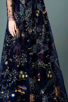I'd love to incorporate stars.   maybe in the neckline beading, swirls like Van Gogh out of sparkles and pearls?