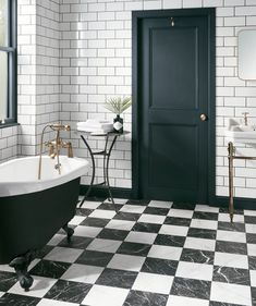Combining black and white marble effect, these Porcelain tiles from Topps Tiles will give your bathroom the ultimate Italian look. Black And White Bathroom Floor, Marble Bathroom Floor, White Marble Bathrooms, Black And White Marble, Large Bathrooms, Bathroom Flooring, Master Bathroom, Modern Floor Tiles, Tile Floor