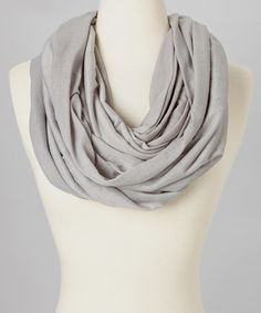 Banish the brrs in soft, singular style. Knit from a caress-able cotton blend and featuring a scrunch- and twist-friendly design, this infinity scarf promises coziness with a hint of class. 34'' W x 74'' circumference65% cotton / 35% polyesterDry cleanImported