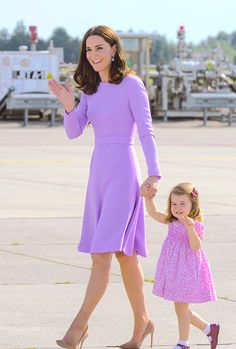 The Duchess of Cambridge and Princess Charlotte waving as they depart from Hamburg airport on the last day of their official visit to Poland and Germany on July 21st, 2017.