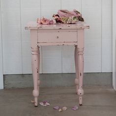 Rachel Ashwell  Shabby Chic Couture-  I love her shade of pink and the roses and hat. I have her books and think she knows what she loves and lives it.
