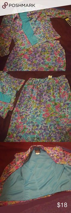 NWT Woman's 2 piece skirt and top NWT Floral colors with skirt and top. Top has six aqua colored buttons. Skirt zips in the back 7 inches. Aqua colored zipper. Positive-Attitude Skirts Skirt Sets