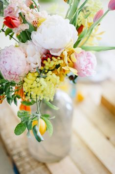 tropical inspired flowers, photo by Debbie Lourens http://ruffledblog.com/nile-inspired-wedding-ideas #weddingcenterpieces