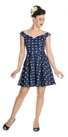 You don't need to know your port from your starboard to wear this Marina Mini Dress. This super cute vintage inspired navy mini dress has capped sleeves wide boat neck with a sweetheart shape with white trim, a fitted bodice and short A-line skirt that flares out from the waist. The cotton blend fabric has an all over repeat pattern of white polka dots and anchors. It' super cute, just finish off the look with some red shoes and nautical accessories in our range.