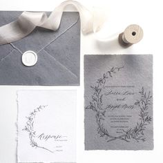 Calligraphy Wedding invitation. Floral wreath, black on gorgeous grey handmade paper and RSVP on cream handmade paper.