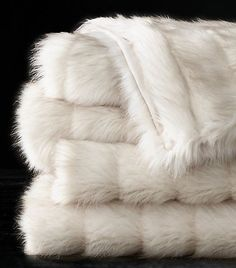 Do you want to up the cozy factor in your home this winter? We rounded up the 13 coziest faux-fur throw blankets to help you hibernate in style.