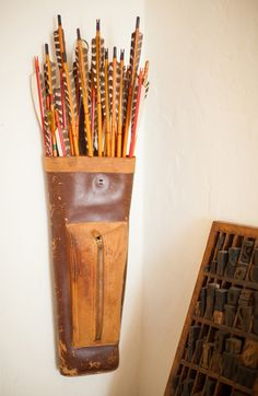 """Sneak Peek: Nicole Sutton of Workhorse. """"I found this leather quiver at a flea market a few years ago. My mom was with me and thought I was nuts to buy it. It got us chatting about her foray into archery as a kid, her tomboy days and dreams to become a farmer/carpenter – it made us laugh and at only $25 I couldn't resist! This set has a tiny leather glove and chalk on the pocket and I'd like to think some spirited lass used these to spear something she was hunting for!"""" #sneakpeek"""
