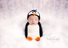 Poppy Penguin Hat and Snuggle Sack Knitting Pattern!  New design.  Baby sizes Newborn, 0-3 Months, 3-6 Month, and 6-12 Month included in hat and sack.  Toddler 1-3 Years and Child 3-10 Years included in hat.                                                                                                                                                     More