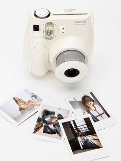 fuji film's instant photo camera : WANT!!!!  but the pictures are smaller than the original :(