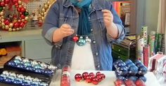 This woman is going to show you how you can make a stunning Christmas decoration and it won't take you very long either. In fact, all you need is a wire hanger and some Christmas bulbs! She starts by taking the hanger and she shapes it into a circle. She then wraps the hanger around itself to create…