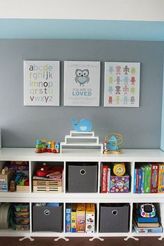Painting the walls a soothing shade of gray and blue added depth and interest to the room. Janey runs an online art shop, Piecemaker Studio, where she sells modern canvas prints for kids. For her son's room, she framed an alphabet canvas, a robot