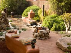 "In this African-inspired outdoor living space, a mixture of textures on the surface, including the rustic timber walkway, give this space an ""untamed, natural look,"" says designer Jamie Durie. Photo by Jason Busch"
