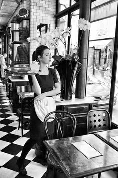 waitress gazing out the window, during a lull in business
