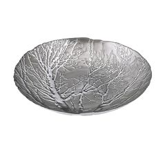 Table decor branches out with an ethereal, silver-plated glass charger embossed with a tree.