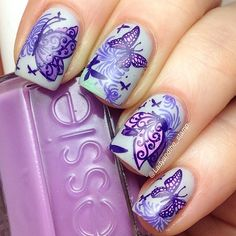 Here's my solo shot of my #bestietwinnails with Tara @thebeautyofnailpolish I used a base of #maybelline cool touch, and stamped a flower image with @bundlemonster 313, then reverse stamped various butterflies from @lesly_plates from @hypnoticpolish LS04 and LS08 and #Konad m21. A few extra tiny butterflies from #mariannenails 11 to finish off! I was really pleased with the end result! All stamping done with @mundodeunas polishes #maybelline #leslyplates #hypnoticpolish #konad #mundodeunas…