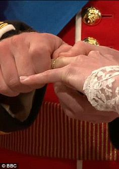 William and Catherine exchanging rings at their ceremony.   (AFP photo)
