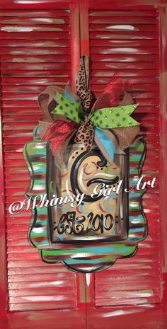 A fun & funky door hanger that will add pizzazz to any entrance! A colorful creation that is super cute. Its created using 1/4 wood, hand painted