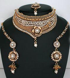 Beautiful White polkistones and Imitation Pearls Design Polki Bridal Gold Plated Jewelry Set-11SMBRJ35   http://www.craftandjewel.com/servlet/the-1712/Beautiful-White-polkistones-and/Detail